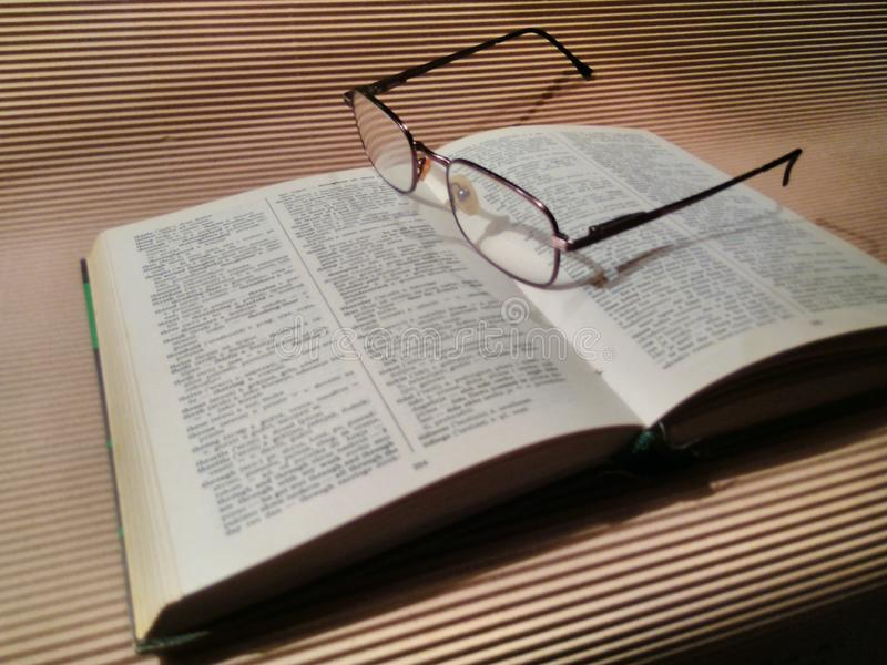 Book. Dictionary, glasses, study, pause, education stock photo