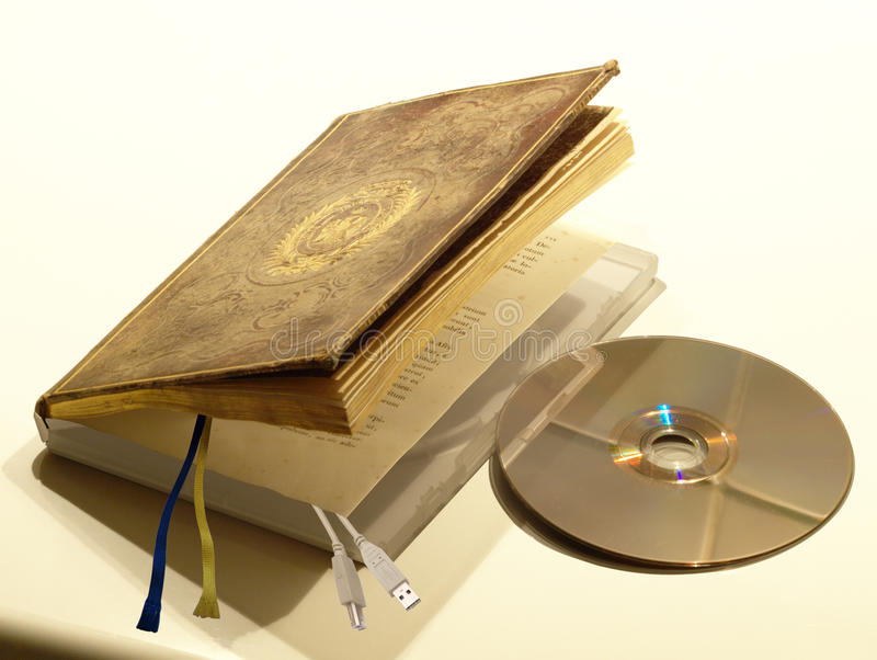 Book digitization. Antique book opens like a DVD case and is equipped with a USB connection. About the scanning of books and the passage from traditional books royalty free stock image