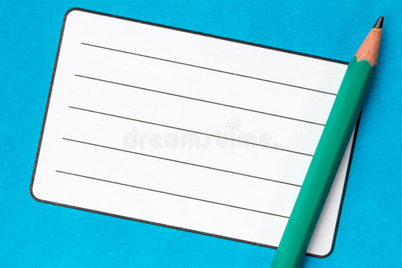 Book with empty name label and pencil. School exercise book with empty name label and pencil royalty free stock photography