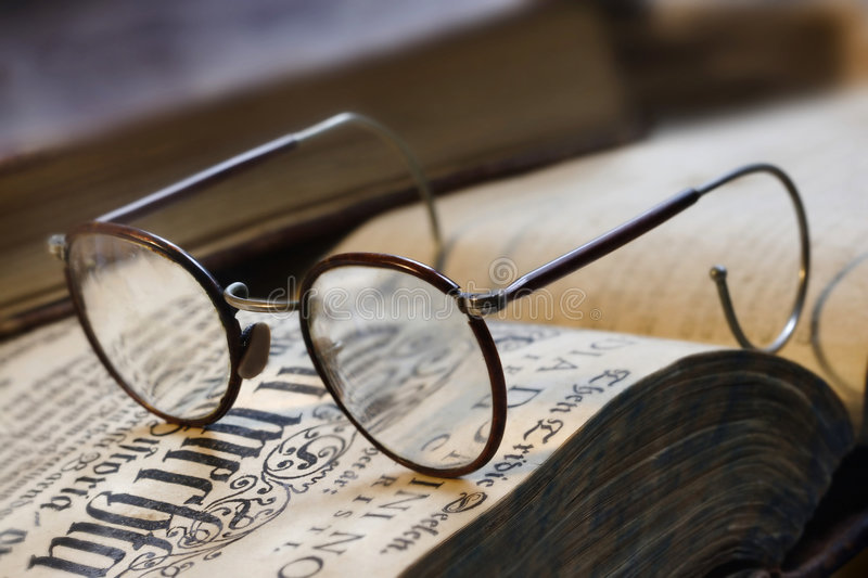 Book and eyeglasses royalty free stock photography