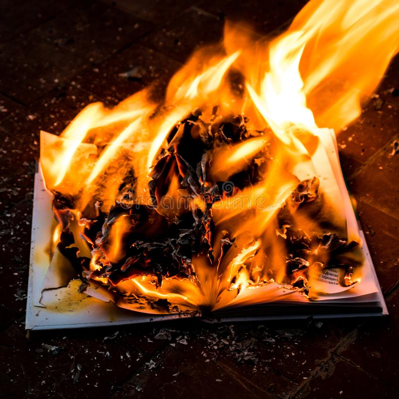 Book is on fire stock photography