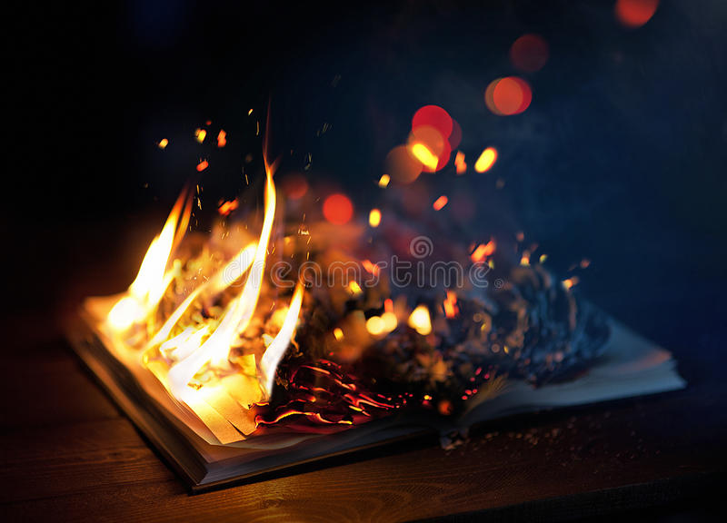Book on fire stock images