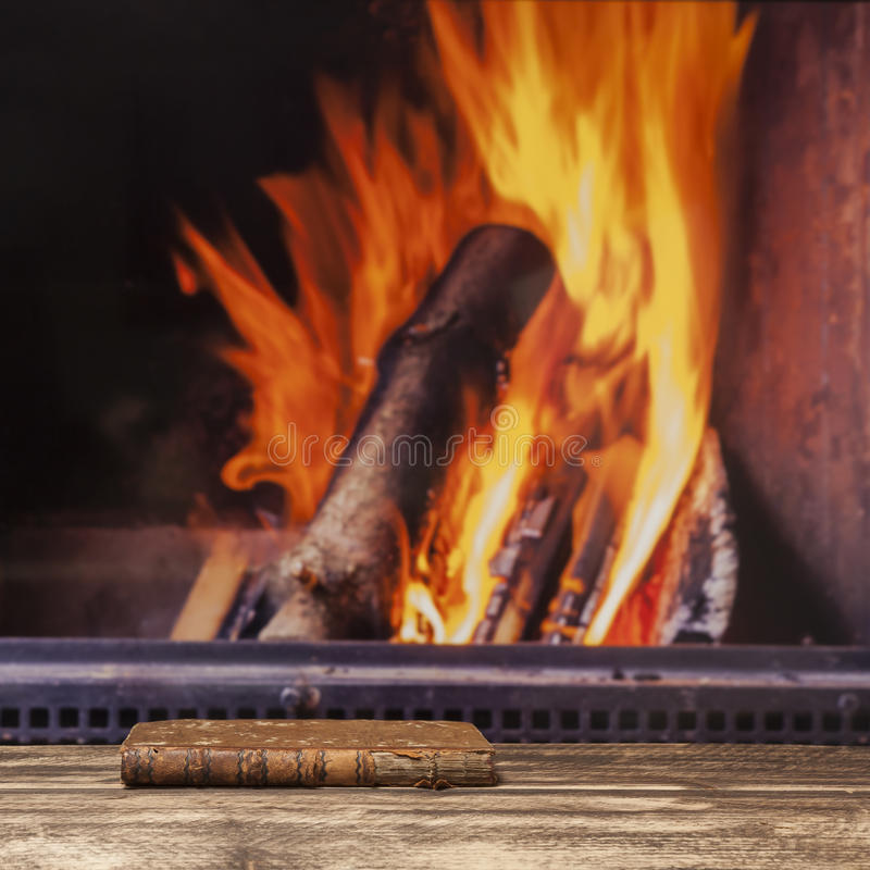 Free Book Fireplace Relax Winter Fall Autumn Rustic Dark Wooden Floor Stock Image - 76620651