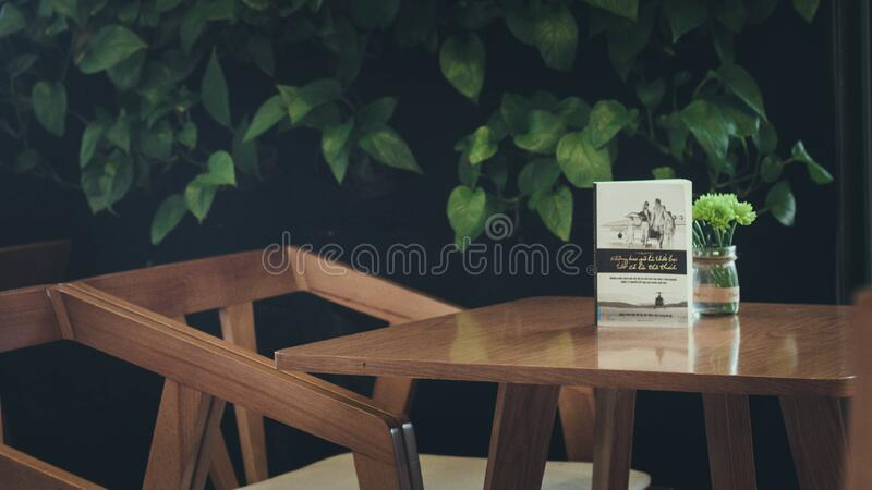 Book And Flowers On Wooden Table Free Public Domain Cc0 Image