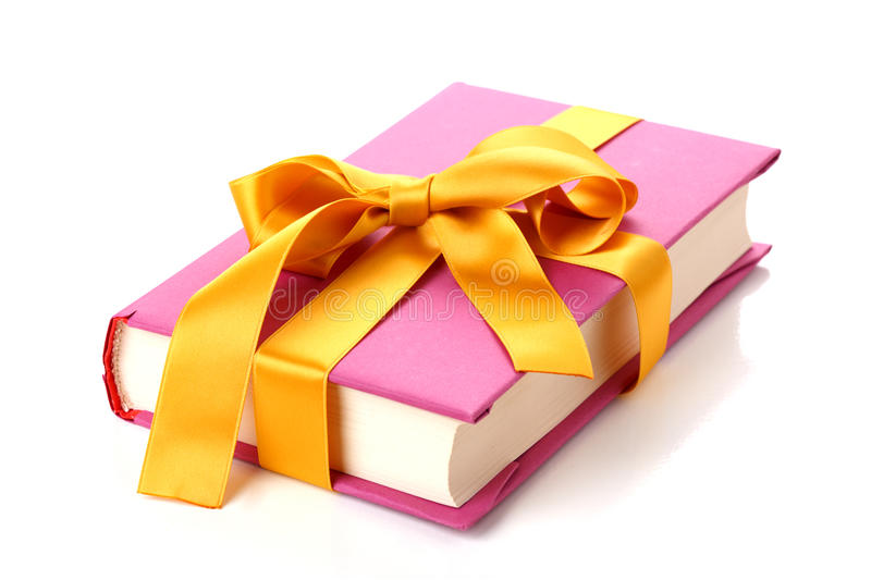 Book gift. Tied with ribbon stock image