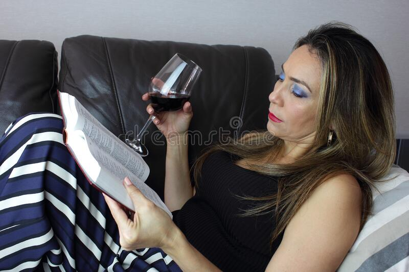 Book with a glass of of wine stock photos