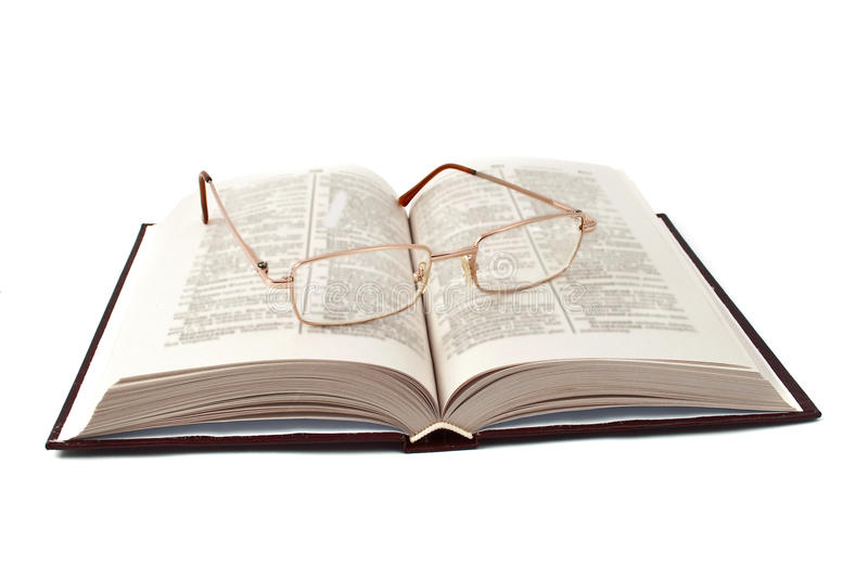 Book with glasses stock photography