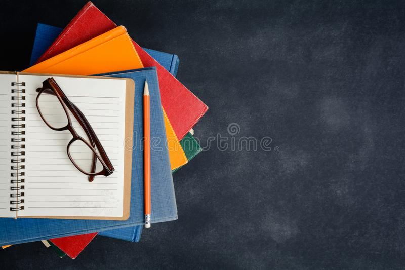Book glasses and pencil on the desk stock photography