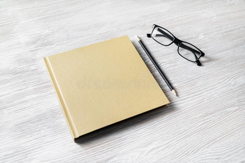 Book, glasses, pencil royalty free stock image