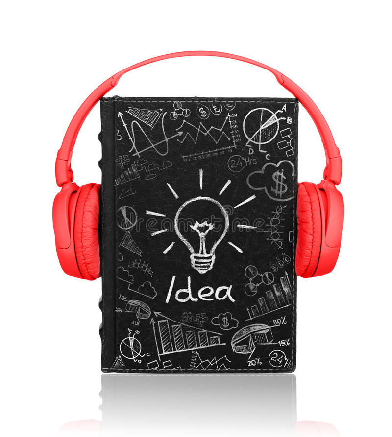 Book with headphones with painted business sketches. And painted bulb, as a concept idea royalty free stock photos