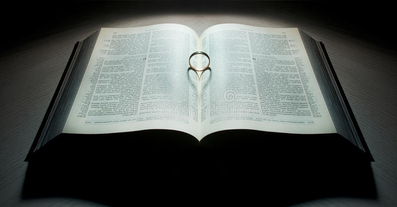 Book with a heart-shaped ring stock photography