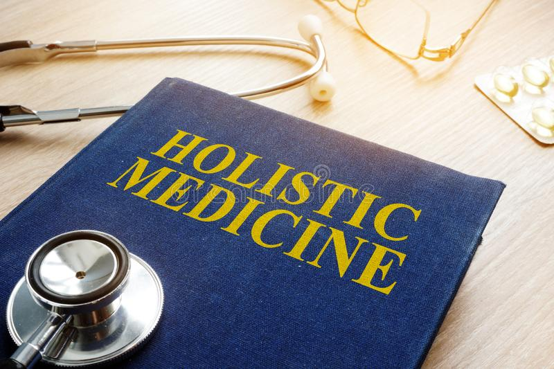 Book about holistic medicine and stethoscope. Book about holistic medicine and stethoscope on a table royalty free stock photos