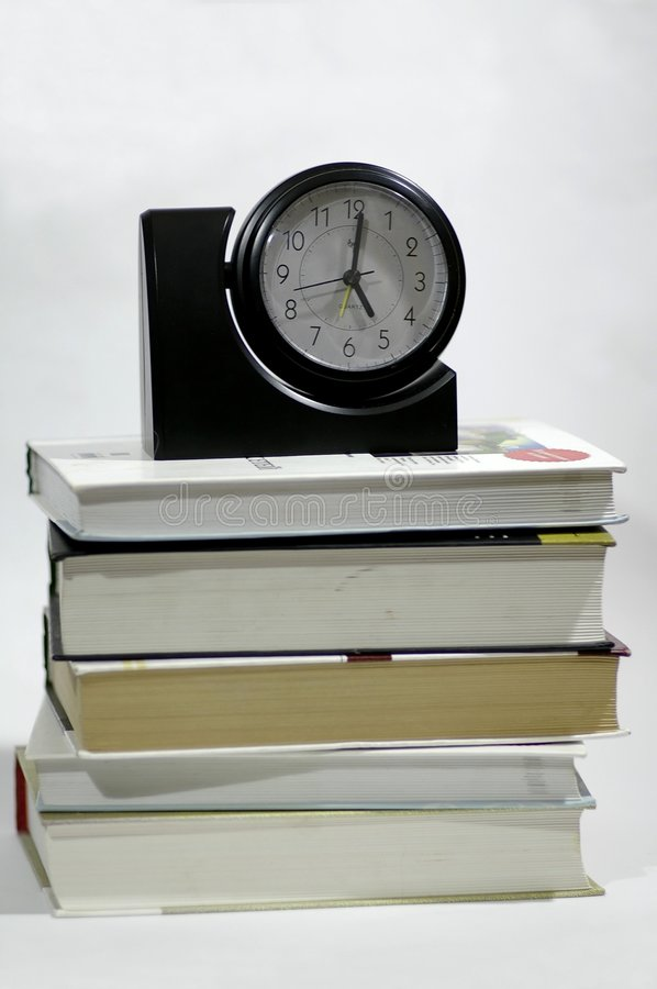 The book and the hours royalty free stock photography