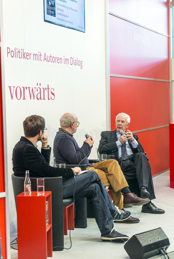 Book launch at the vorwaerts stand at the Frankfurt Book Fair 2014. FRANKFURT AM MAIN, GERMANY - OCT 12, 2014: Panel discussion with Klaus von Dohnanyi and Rolf royalty free stock photography