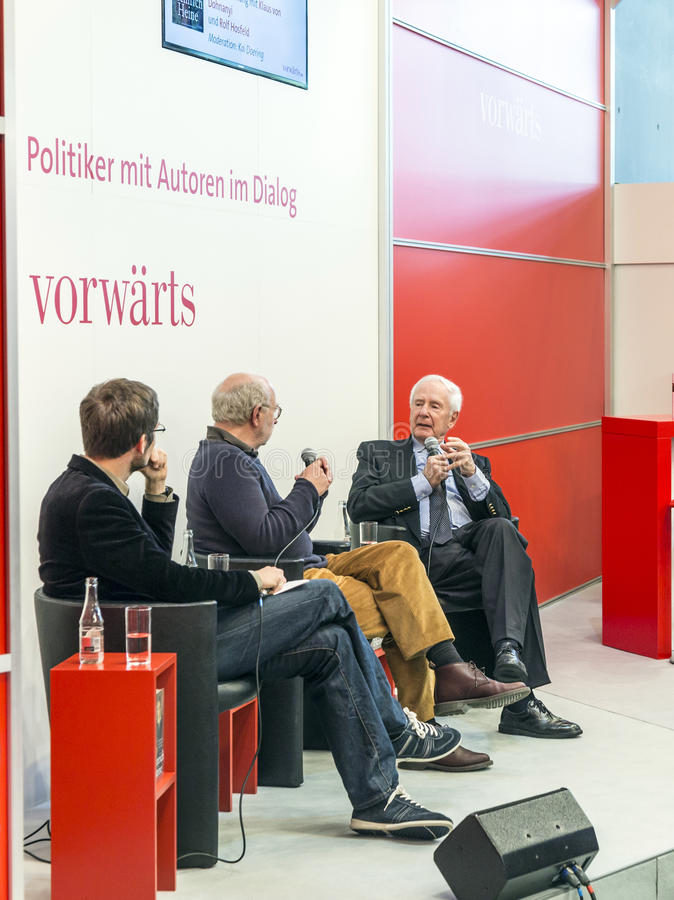 Book launch at the vorwaerts stand at the Frankfurt Book Fair 2014. FRANKFURT AM MAIN, GERMANY - OCT 12, 2014: Panel discussion with Klaus von Dohnanyi and Rolf stock photography