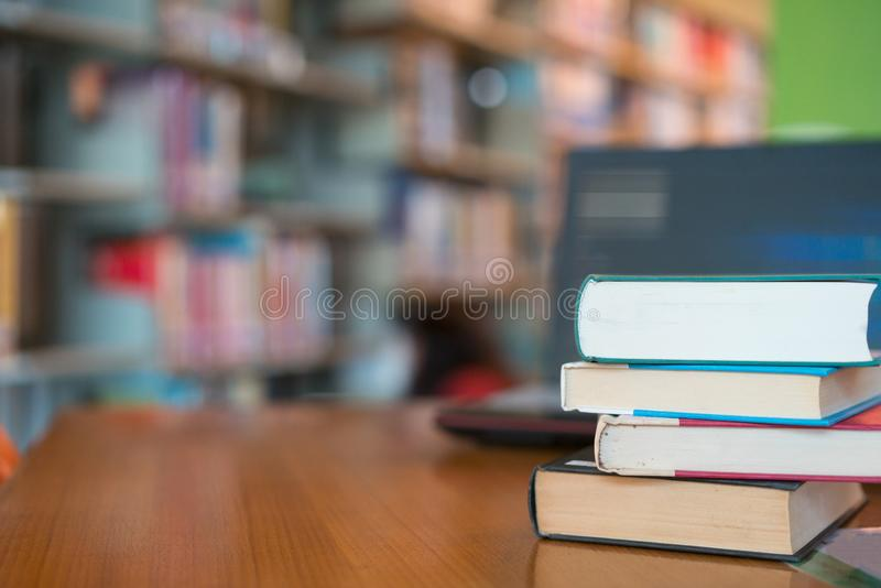 Book in library with old open textbook, stack piles of literature text archive on reading desk royalty free stock photos