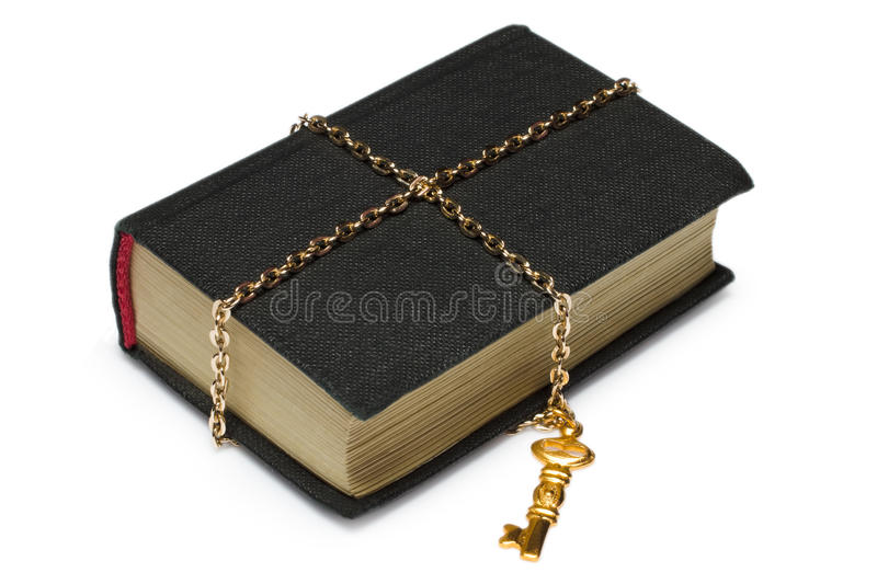 Book locked with key and chains stock photography