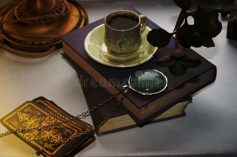 Book locket magic divination love paper sheet chain gemstone a Cup of coffee royalty free stock photo