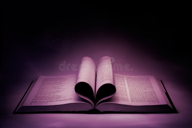 The Book of Love. The ages of a volume form a dark shaded heart. Painted with light royalty free stock image