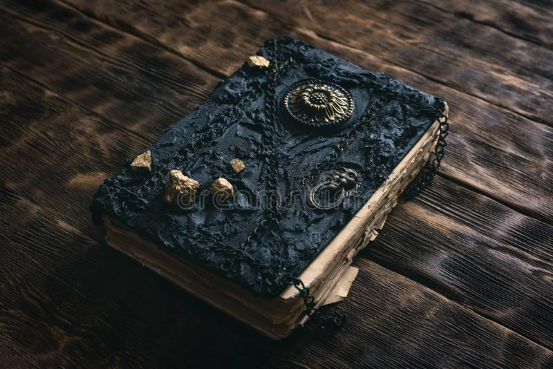 Book of magic. Ancient magic book on a wooden table background. Spellbook stock photo