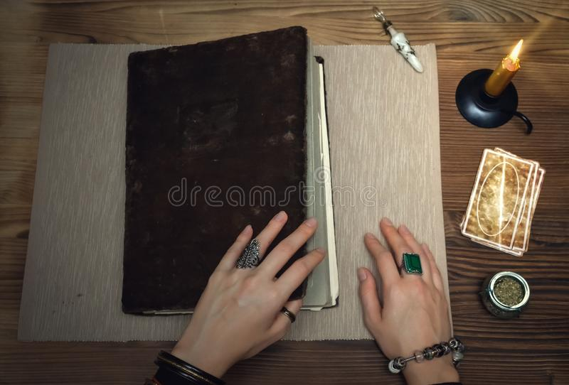 Book of magic. Tarot cards. Future reading. Fortune teller concept. Book of magic with mystical light. Tarot cards on fortune teller desk table. Future reading stock photo