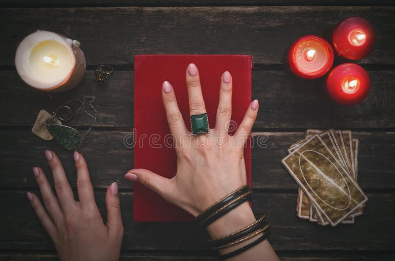 Book of magic and tarot cards. Book of magic and tarot cards on fortune teller table background. Futune reading concept. Divination stock images