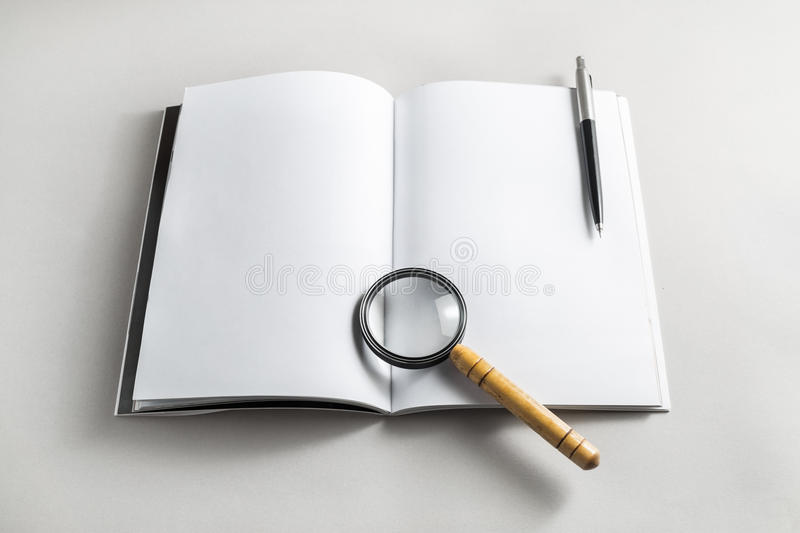 Book, magnifier and pencil royalty free stock images