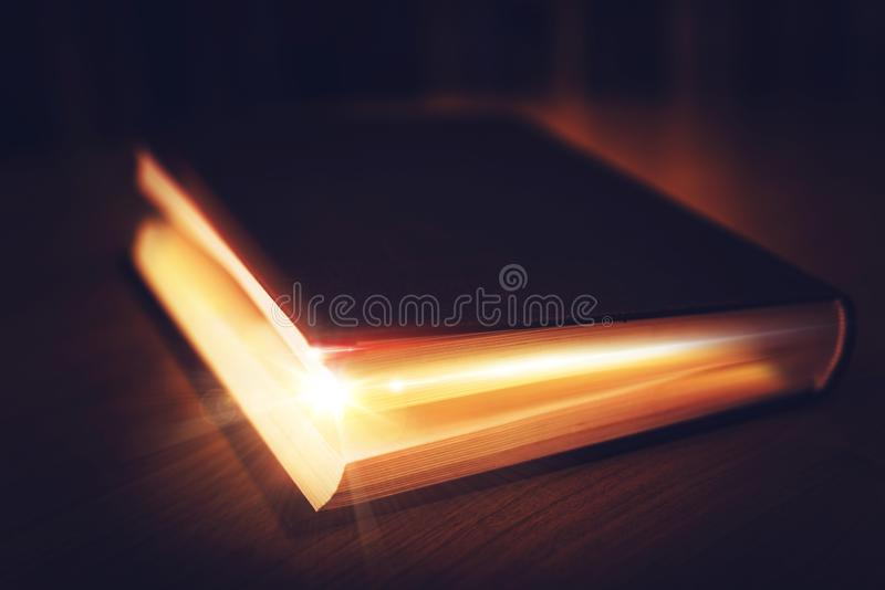Book of Mysteries. Old Book with Glowing Content. Magical Book royalty free stock photography