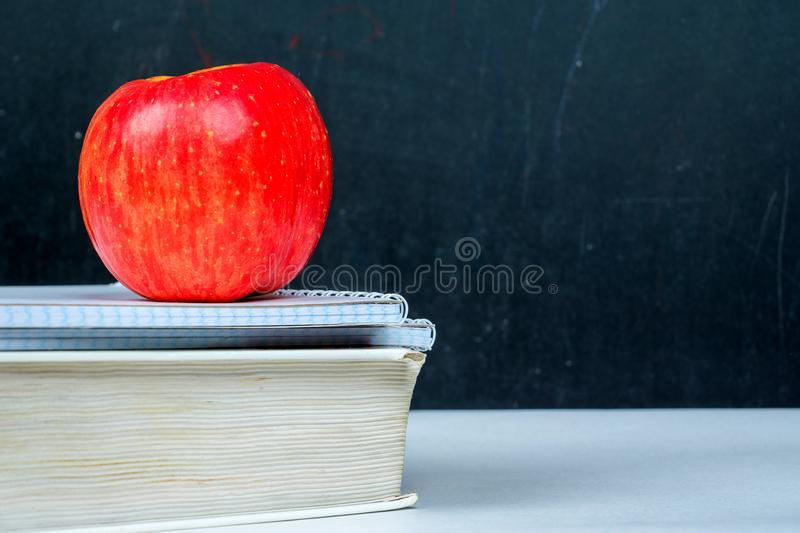 Book notebooks apple, new school year royalty free stock photo