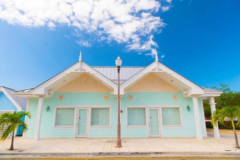 Book now pay later. Houses little cute apartments tropic island with palm trees on sunny summer day. Holiday houses stock photo