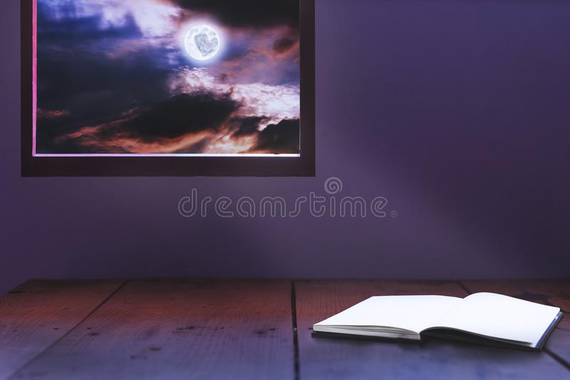 Book open dramatic feeling with moon light in midnight royalty free stock images