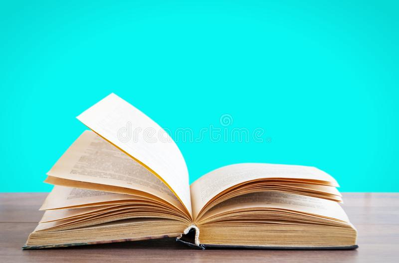 Book with open pages on a wooden surface stock photography