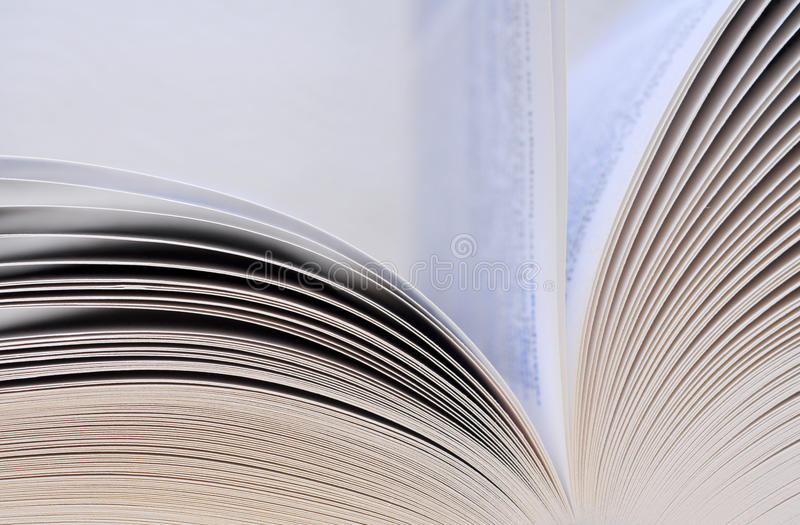 Book pages closeup. Open book with flying pages royalty free stock photo