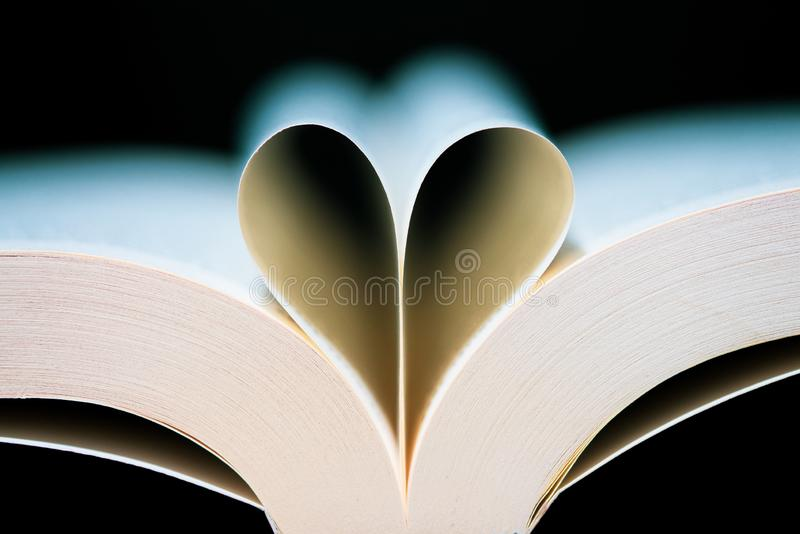 Book pages heart shaped royalty free stock images