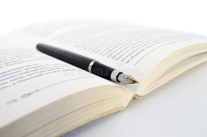 Book with pen stock image