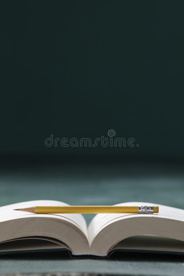 Book and pencil royalty free stock photos