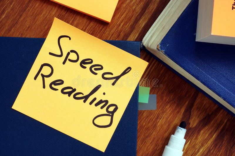 Book and piece of paper with sign speed reading. Blue book and piece of paper with sign speed reading stock photography