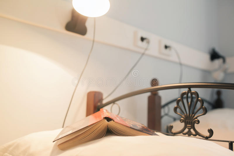 Book on the pillow stock photos