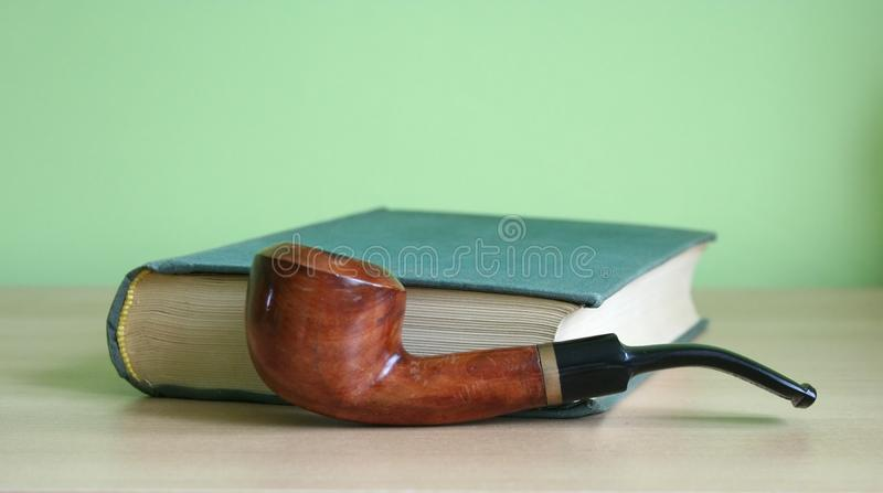 Book and a pipe royalty free stock photo