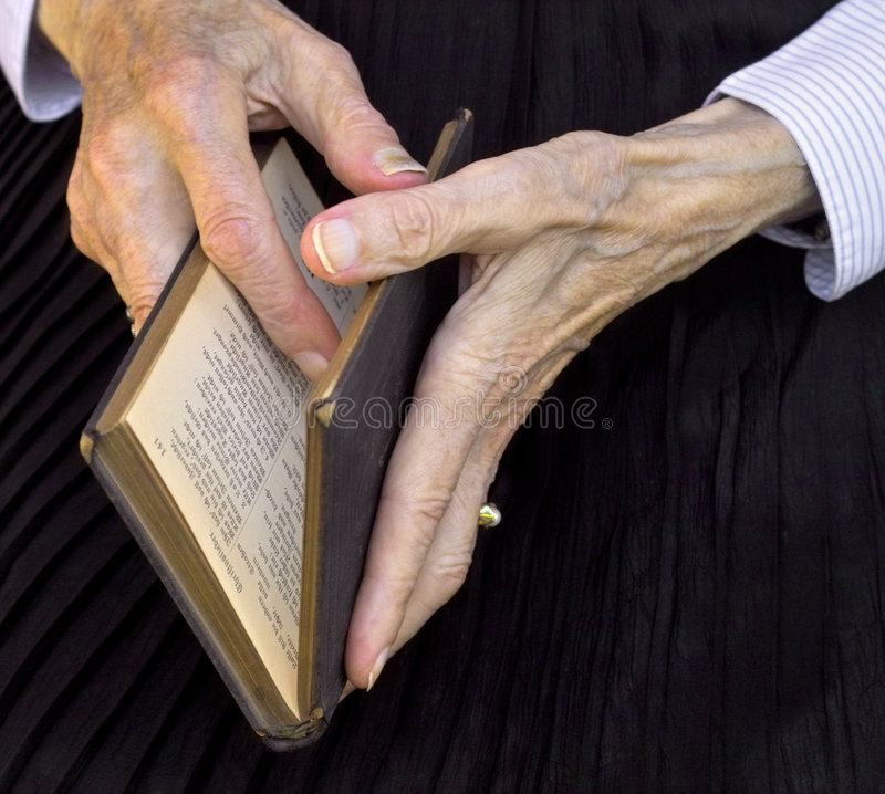 Book of psalms. Grandma reading in the book of psalms royalty free stock photos