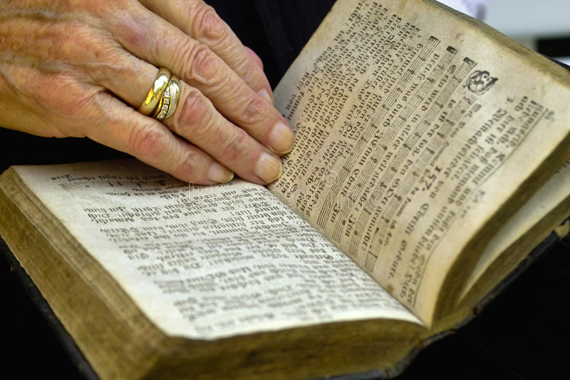 Book of psalms. Reading an old book of psalms royalty free stock photography