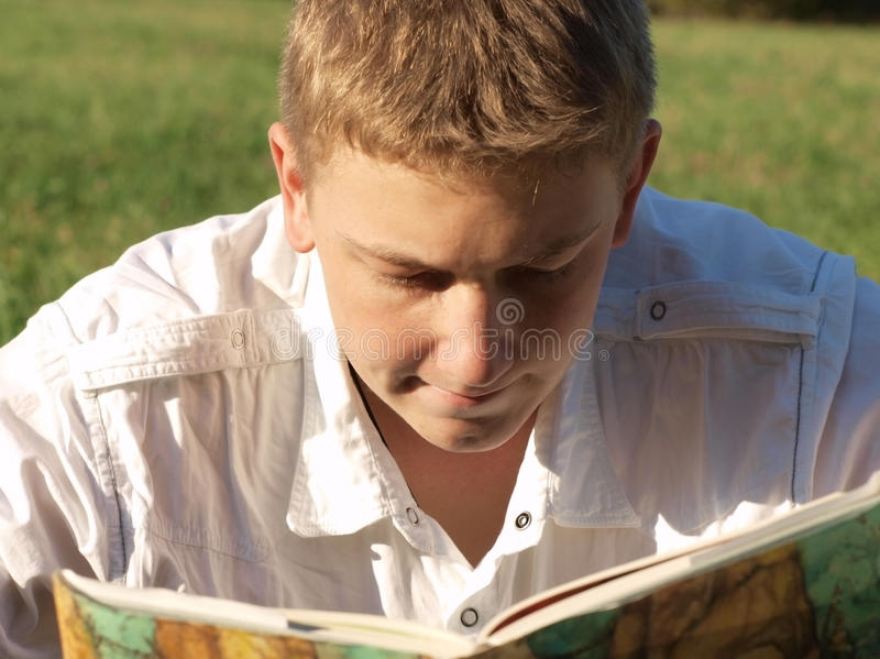 Download Book reading stock photo. Image of book, grass, concentrated - 11296726