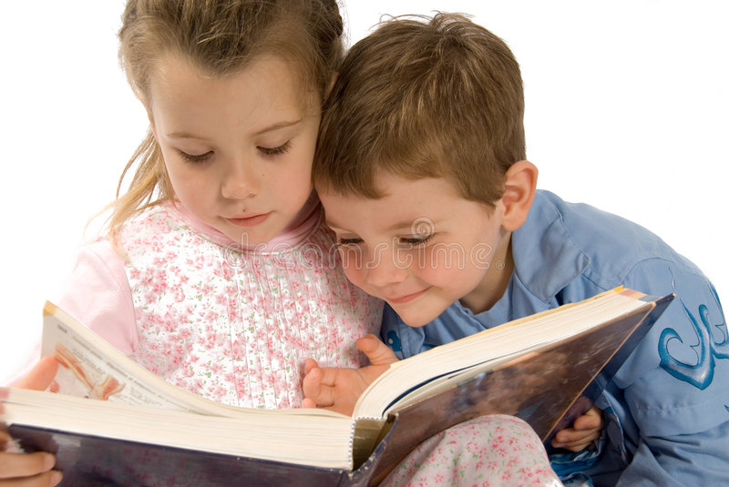 Book reading. Brother and sister having fun with a book stock photography