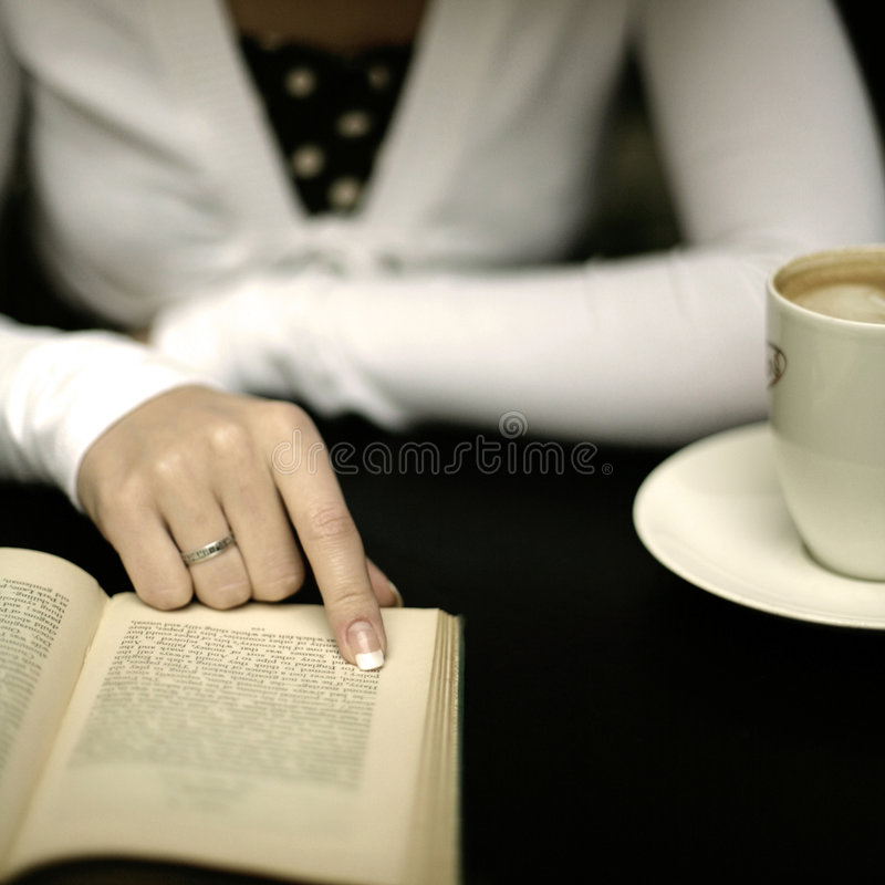 Book reading in coffee shop royalty free stock image