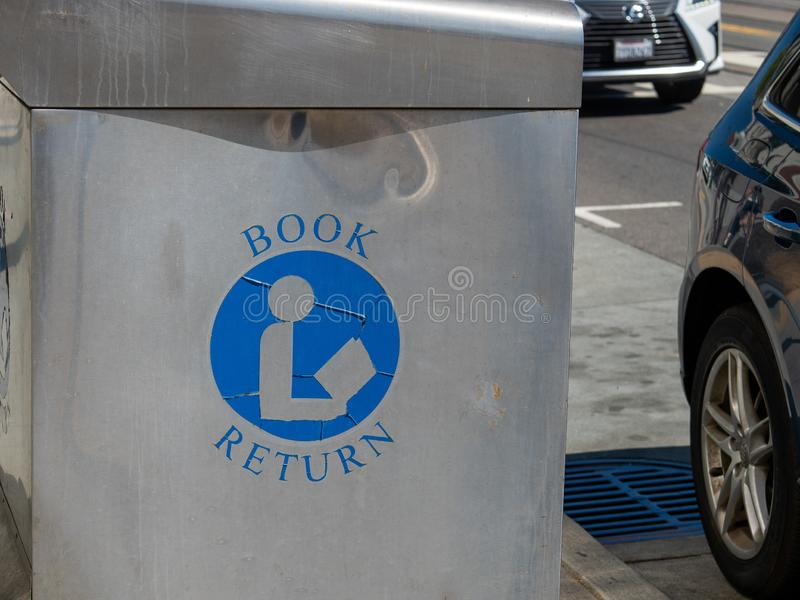Book return symbol and label on outdoor book drop on street at library. Book return symbol and label on outdoor book drop on street at a library royalty free stock photos