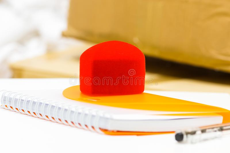 Book with ring box and ballpen. Closeup view of a book with ring box and ballpen royalty free stock images