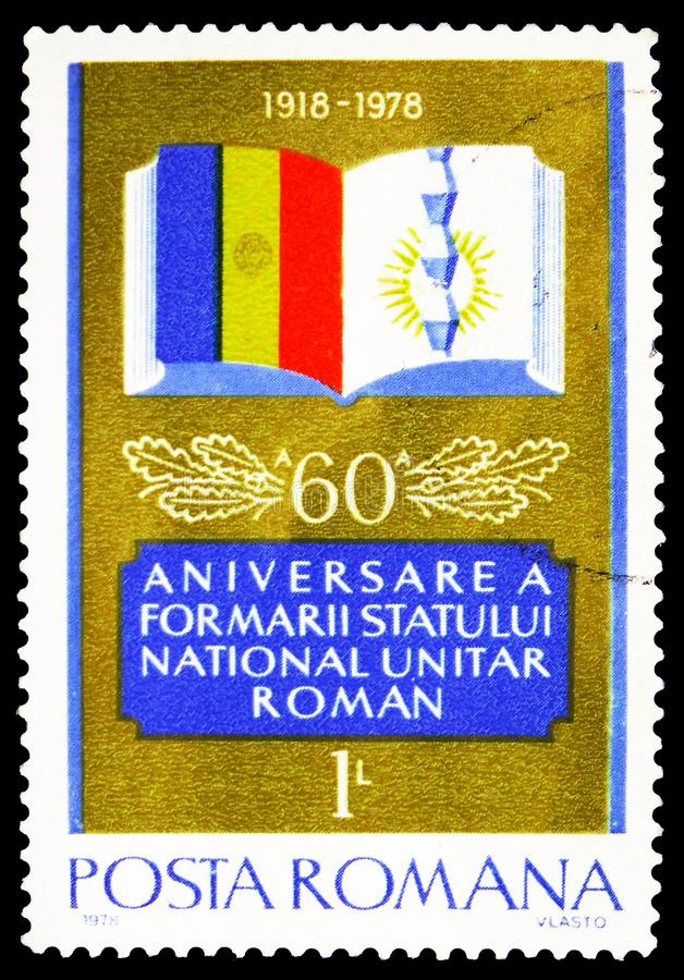 Book and Romanian flag, 60th Anniversary of National Unity serie, circa 1978. MOSCOW, RUSSIA - FEBRUARY 20, 2019: A stamp printed in Romania shows Book and royalty free stock images