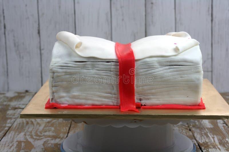 Book shaped cake. Fondant with Christmas theme stock photo
