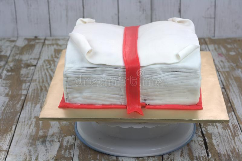 Book shaped cake. Fondant with Christmas theme stock photos