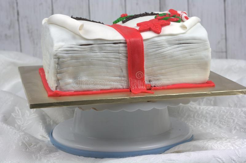 Book shaped cake. Fondant with Christmas theme royalty free stock photography